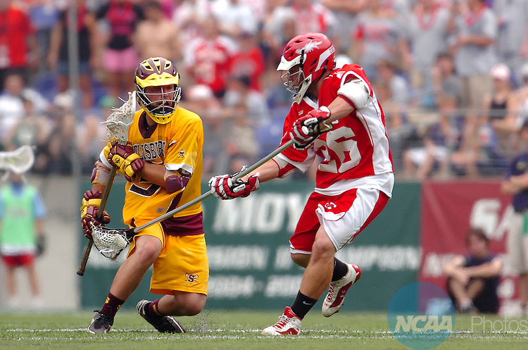 27 May 2007: Cortland midfielder Bruce Richardson (red) tries to check the ball away from Salisbury's Mike Edwards as he tries to push the ball upfield during the Division III Men?s Lacrosse Championship held at M&T Bank Stadium in Baltimore, MD. Salisbury defeated Cortland 15-9 for the national title.  Larry French/NCAA Photos