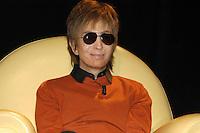 MICHAEL CIMINO.Travel in the American cinema, Park of Music, .Auditorium Rome, Italy, April 14th 2007..half length sunglasses orange jumper top black shirt sitting.CAP/CAV.©Luca Cavallari/Capital Pictures.
