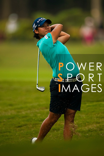 Yani Tseng of Taiwan plays her second shot on the 14th hole during day one of the Sunrise LPGA Taiwan Championship 2011 at the Sunrise Golf & Country Club on 20 October 2011 in Tao Yuan, Taiwan. Photo by Victor Fraile / The Power of Sport Images