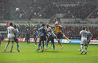 Sunday, 26 April 2014<br /> Pictured:Aston Villa goalkeeper Brad Guzam (yellow) punches the ball away from a Swansea corner kick.<br /> Re: Barclay's Premier League, Swansea City FC v Aston Villa at the Liberty Stadium, south Wales.