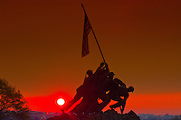 Statue of Marines holding up the American Flag at the Iwo Jima Memorial (United States Marine Corps War Memorial) at sunrise, Arlington, Virginia