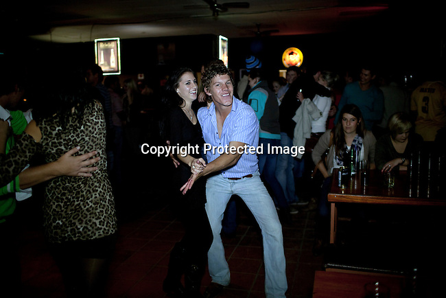 BLOEMFONTEIN, SOUTH AFRICA APRIL 19, 2013: Afrikaners dance to traditional Afrikaner music at the Wiesbaden nightclub outside Bloemfontein, South Africa. Not one single black person in attendance, and most black person would never dare to go to this place. Photo by: Per-Anders Pettersson