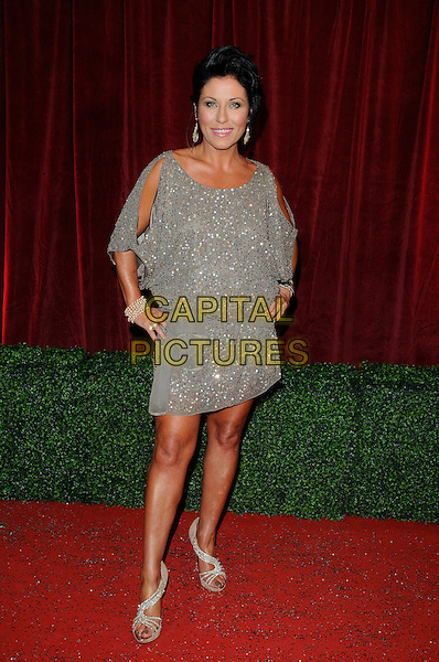 Jessie Wallace .Eastenders.Attending the British Soap Awards 2012.at the London Television Centre, London, England, UK, 28th April 2012..arrivals full length slit split sleeve grey gray silver dress sequined sequin sparkly earrings tanned sandals hands on hips .CAP/CAN.©Can Nguyen/Capital Pictures.