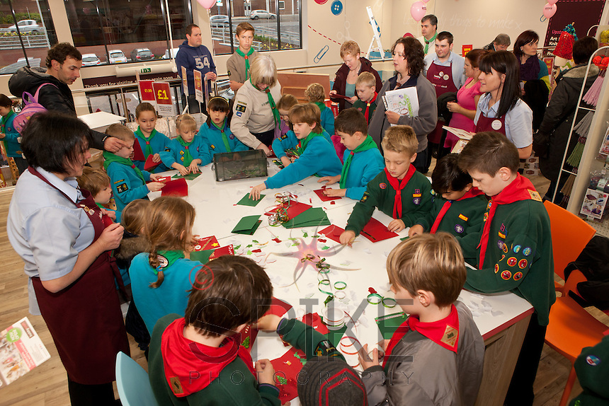 Scouts and Beavers from 1st Hasland and 2nd and 3rd Brampton Scouts try their hands at making Christmas Cards