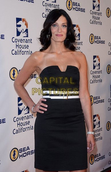 Dayanara Torres.Covenant House California 2011 Gala and Awards Dinner held at The Skirball Cultural Center, Los Angeles, CA, USA, .9th June 2011..half length strapless dress  black white belt hand on hip .CAP/ADM/TW.©Tonya Wise/AdMedia/Capital Pictures.