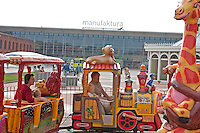 Family and children on train at Manufaktura providing entertainment culture and shopping. Balucki District Lodz Central Poland