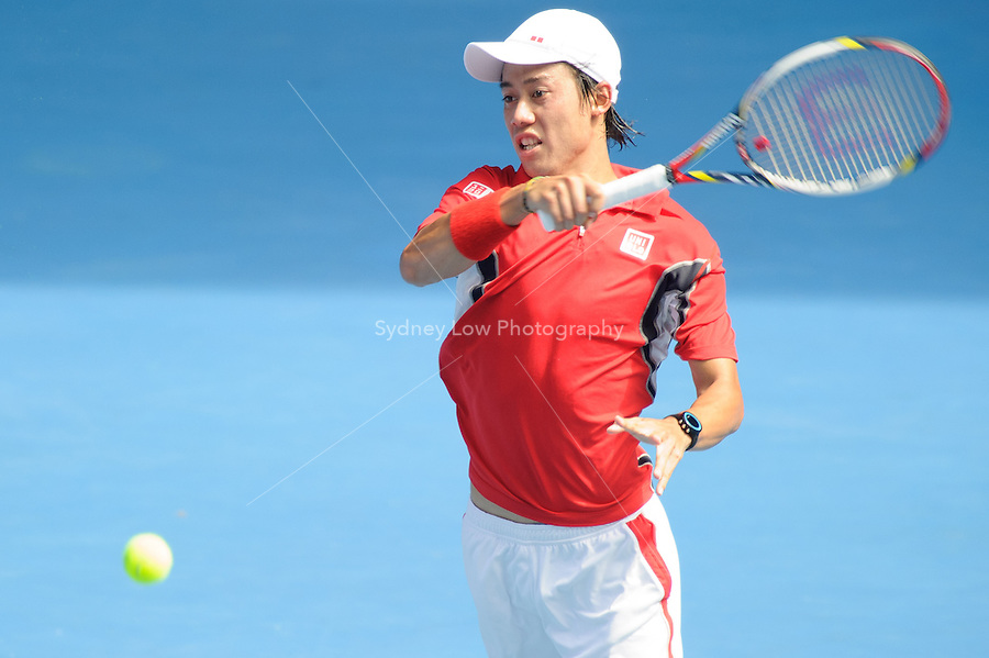 MELBOURNE, 25 JANUARY - Kei Nishikori (JPN) in action against Andy Murray (GBR) during a men's quarterfinals match on day ten of the 2012 Australian Open at Melbourne Park, Australia. (Photo Sydney Low / syd-low.com)