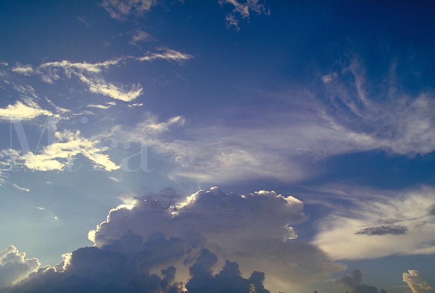 Cumulus, cumulonimbus and cirrus clouds, blue sky; mares tails. Houston Texas.
