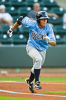 Adrian Ortiz #6 of the Wilmington Blue Rocks hustles down the first base line against the Winston-Salem Dash at  BB&T Ballpark August 4, 2010, in Winston-Salem, North Carolina.  Photo by Brian Westerholt / Four Seam Images