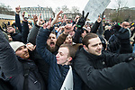 """© Joel Goodman - 07973 332324. 18/03/2018 . London , UK . Supporters of Tommy Robinson and Martin Sellner celebrate the speech going ahead after Tommy Robinson leaves . 1000s including supporters of alt-right groups such as Generation Identity and the Football Lads Alliance , at Speakers' Corner in Hyde Park where Tommy Robinson reads a speech by Generation Identity campaigner Martin Sellner . Along with Brittany Pettibone , Sellner was due to deliver the speech last week but the pair were arrested and detained by police when they arrived in the UK , forcing them to cancel an appearance at a UKIP """" Young Independence """" youth event , which in turn was reportedly cancelled amid security concerns . Photo credit : Joel Goodman"""