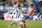 Atletico de Madrid's Augusto Fernandez (r) and Real Sociedad's Carlos Vela during La Liga match. March 1,2016. (ALTERPHOTOS/Acero)
