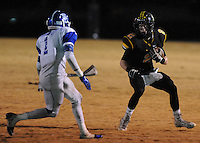 NWA Democrat-Gazette/ANDY SHUPE<br /> Isaac Disney (2) of Prairie Grove carries the ball past Eric Briggs (1) of Star City Friday, Nov. 27, 2015, during the first half of play at Tiger Stadium in Prairie Grove. Visit nwadg.com/photos to see more photographs from the game.