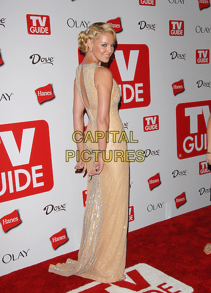 KATHERINE HEIGL.The 4th Annual TV Guide Post Emmy Party held at Social in Hollywood, California, USA..August 27th, 2006.Ref: DVS.full length cream dress silver looking over shoulder peach.www.capitalpictures.com.sales@capitalpictures.com.©Debbie VanStory/Capital Pictures