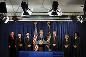 United States President Barack Obama (C) delivers remarks beside officials during a visit to the Consumer Financial Protection Bureau in Washington DC, USA, on 06 January 2012. Obama placed Richard Cordray (3-R) as head of the Consumer Financial Protection Bureau with a recess appointment 04 January 2012. Republicans in the Senate had blocked Cordray's confirmation in December 2011..Credit: Michael Reynolds / Pool via CNP