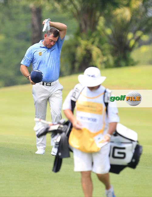 Lee Westwood (ENG) feeling the heat on the 2nd fairway during Round 1 of the Maybank Championship at the Saujana Golf and Country Club in Kuala Lumpur on Thursday 1st February 2018.<br /> Picture:  Thos Caffrey / www.golffile.ie<br /> <br /> All photo usage must carry mandatory copyright credit (© Golffile | Thos Caffrey)
