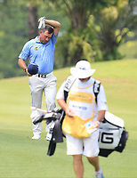 Lee Westwood (ENG) feeling the heat on the 2nd fairway during Round 1 of the Maybank Championship at the Saujana Golf and Country Club in Kuala Lumpur on Thursday 1st February 2018.<br /> Picture:  Thos Caffrey / www.golffile.ie<br /> <br /> All photo usage must carry mandatory copyright credit (&copy; Golffile | Thos Caffrey)
