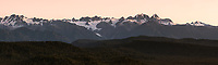 Pastel sunset over Southern Alps and Franz Josef Glacier viewed from Okarito lookout Westland Tai Poutini National Park, West Coast, South Westland, UNESCO World Heritage Area, New Zealand, NZ