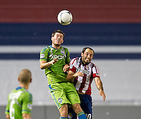 CARSON, CA - August 25, 2012: Seattle midfielder Brad Evans (3) and Chivas USA midfielder Nick LaBrocca (10) during the Chivas USA vs Seattle Sounders match at the Home Depot Center in Carson, California. Final score, Chivas USA 2, Seattle Sounders 6.