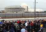 PHILADELPHIA - MARCH 21: Spectators look on as Veteran's Stadium, the former home of the Philadelphia Phillies is imploded to make way for a parking lot March 21, 2004 in Philadelphia, Pennsylvania. The Philadelphia Phillies new hone, Citizen's Bank Park will open next to where Veteran's Stadium stood in April. (Photo by William Thomas Cain/Getty Images)