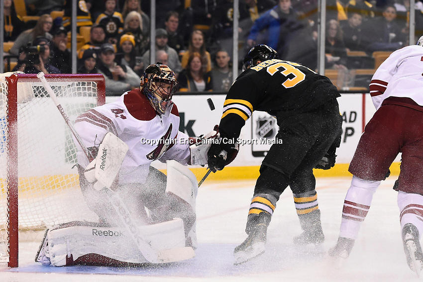 February 28, 2015 - Boston, Massachusetts, U.S. - Arizona Coyotes goalie Mike Smith (41) waatches the puck as Boston Bruins center Patrice Bergeron (37) closes in during the NHL match between the Arizona Coyotes and the Boston Bruins held at TD Garden in Boston Massachusetts. Eric Canha/CSM