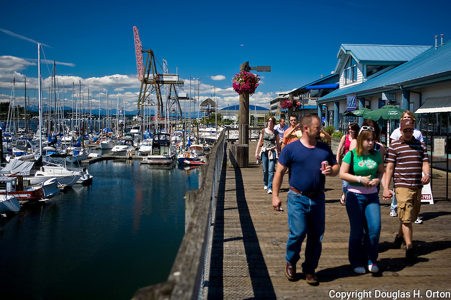Mile long Percival Landing Boardwalk along Budd Bay passes marinas, fine restaurants and the Farmer's Market along the way to Olympia Waterfront Plaza.