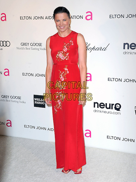 Lucy Lawless.The 21st Annual Elton John AIDS Foundation Academy Awards Viewing Party held at The City of West Hollywood Park in West Hollywood, California, USA..February 24th, 2013.oscars full length red sleeveless pink floral print dress embroidered .CAP/DVS.©DVS/Capital Pictures.