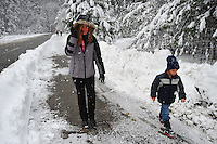 Nov. 22, 2010 -Yosemite Valley, CA, U.S. - Yosemite Valley visitors walk near Curry Village  after a nighttime snow storm in Yosemite Valley November 22, 2010. According to regulars at the National Park, this is Yosemite's first snow covered Thanksgiving in nine years. (Photo by Alan Greth)