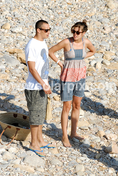 **ALL ROUND PICTURES FROM SOLARPIX.COM**.**WORLDWIDE SYNDICATION RIGHTS EXCLUDING SPAIN - NO PUBLICATION IN SPAIN**.Princess Charlotte Casiraghi of Monoco with her new boyfriend together with friends on the beach, jetskis and  a boat in Ibiza on Monday 13th August, 2007...This pic: Charlotte Casiraghi & Boyfriend..JOB REF: 4470  MAD/ROL       DATE: 13_08_2007.**MUST CREDIT SOLARPIX.COM OR DOUBLE FEE WILL BE CHARGED* *UNDER NO CIRCUMSTANCES IS THIS IMAGE TO BE REPRODUCED FOR ANY ONLINE EDITION WITHOUT PRIOR PERMISSION*