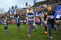 James Haskell of Wasps and Francois Louw of Bath Rugby run out onto the field with the matchday mascots. European Rugby Champions Cup match, between Bath Rugby and Wasps on December 19, 2015 at the Recreation Ground in Bath, England. Photo by: Patrick Khachfe / Onside Images