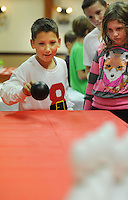 DJ O'Connor (left) and Christina Fox-Brooks, 9 plays a game with friends at his Birthday party Wednesday October 14, 2015 at Twining Hall in Bensalem, Pennsylvania.  (Photo by William Thomas Cain)
