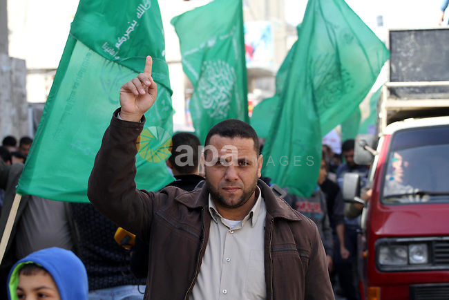 Palestinians shout slogans during a protest against the United Nations decision to suspend payments for Palestinians, whose houses were damaged during a 50-day war last summer, in Beit Hanoun in the northern Gaza Strip January 30, 2015. The main U.N. aid agency in the Gaza Strip said on Tuesday a lack of international funding had forced it to suspend payments to tens of thousands of Palestinians for repairs to homes damaged in last summer's war. Photo by Mohammed Asad