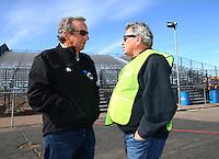 Feb 4, 2016; Chandler, AZ, USA; NHRA team owner Don Schumacher (left) talks with photographer Richard Shute during pre season testing at Wild Horse Pass Motorsports Park. Mandatory Credit: Mark J. Rebilas-USA TODAY Sports