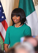 First lady Michelle Obama smiles during a reception for Prime Minister Enda Kenny of Ireland in the East Room of the White House in Washington, D.C., March 19, 2013 in Washington, DC. <br /> Credit: Olivier Douliery / Pool via CNP