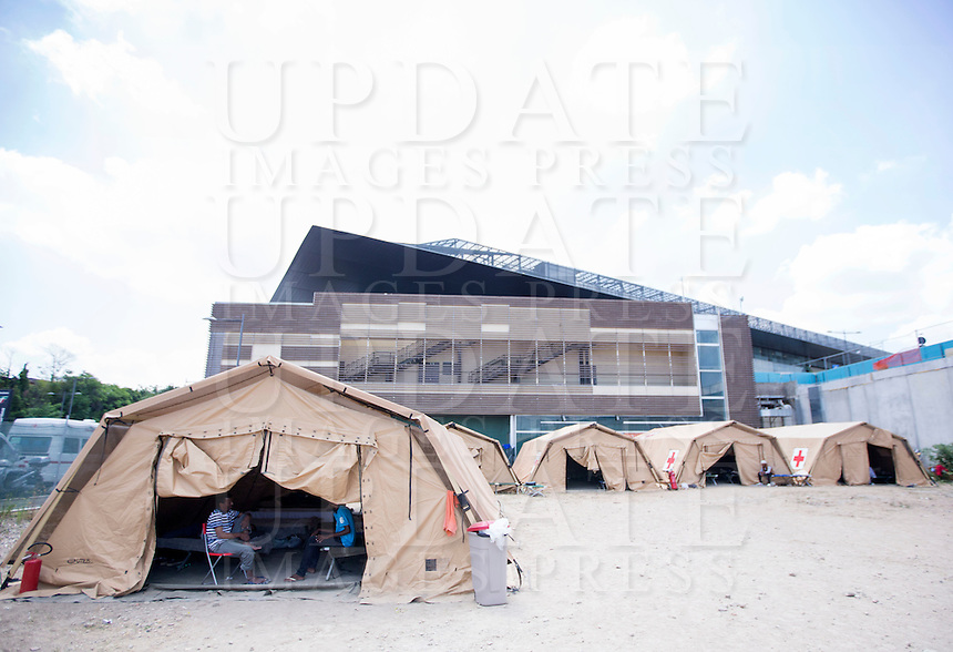 Migranti nella tendopoli allestita presso la stazione Tiburtina a Roma, 16 giugno 2015.<br /> A view of the tent camp set up near the Tiburtina railway station in Rome, 15 June 2015. Italy is facing a huge flow of migrants brought to Sicily after rescue at sea, many of whom are trying to join their relatives in northern Europe. <br /> UPDATE IMAGES PRESS/Riccardo De Luca