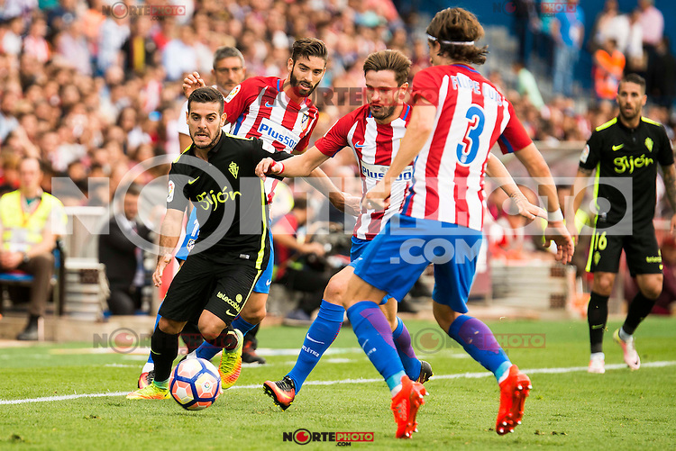 Atletico de Madrid's player Yannick Carrasco, Saul Ñiguez and Filipe Luis and Sporting de Gijon's player Victor R. during a match of La Liga Santander at Vicente Calderon Stadium in Madrid. September 17, Spain. 2016. (ALTERPHOTOS/BorjaB.Hojas) /NORTEPHOTO