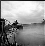 1997-Glen Wilsey of the Everglads takes his airboat out for a quick engine check, before heading on an extended trip.  The Florida Everglades are a disappearing world. Overpopulation, the sugar and cattle industry, mismanagement of the land, droughts and bush fires are just a few of the problems the Florida Everglades are facing. Here Glen Wilsey driving his airboat. According to Glen the best thing about being a tour guide in the everglades is driving the airboats. Riding an airboat is fun but driving an airboat is an awesome feeling.