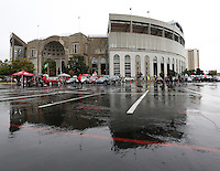 A sparse crowd tailgates in the rain outside Ohio Stadium prior to the NCAA football game against Florida A&M in Columbus on Sept. 21, 2013. (Adam Cairns / The Columbus Dispatch)