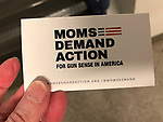Hempstead, New York, USA. May 23, 2018. MOM DEMAND ACTION Legislative Lead DIANE COSTELLO, shows her business card, attending Day 1 of New York State Democratic Convention, held at Hofstra University on Long Island. Moms Demand Action is an organization promoting gun sense in America.