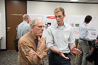 "Nickolas Trzcinko '17 discusses his work on ""Exploring the Memory Query Problem Space"" with trustee John Power '58<br /> Occidental College's Undergraduate Research Center hosts their annual Summer Research Conference on Aug. 4, 2016. Student researchers presented their work as either oral or poster presentations at the final conference. The program lasts 10 weeks and involves independent research in all departments.<br /> (Photo by Marc Campos, Occidental College Photographer)"