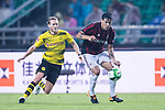 AC Milan Defender Gustavo Gomez (R) plays against Borussia Dortmund Midfielder Andre Schurrle (L) in action during the International Champions Cup 2017 match between AC Milan vs Borussia Dortmund at University Town Sports Centre Stadium on July 18, 2017 in Guangzhou, China. Photo by Marcio Rodrigo Machado / Power Sport Images