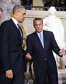 United States President Barack Obama, left, and Speaker of the U.S. House John Boehner (Republican of Ohio), right, look on after unveiing the statue of Rosa Parks at the United States Capitol February 27, 2013 in Washington, DC. .Credit: Olivier Douliery / Pool via CNP