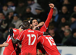 Emre Can of Liverpool raises his arm in celebration as scorer Philippe Coutinho of Liverpool is mobbed - FA Cup Fourth Round replay - Bolton Wanderers vs Liverpool - Macron Stadium  - Bolton - England - 4th February 2015 - Picture Simon Bellis/Sportimage