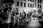 Albany, New York<br /> USA<br /> July 8, 2010<br /> <br /> People dance at a summer night street party in the center of the city.