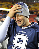 Landover, MD - December 27, 2009 -- Dallas Cowboys quarterback Tony Romo (9) holds his hat on his head after the game against the Washington Redskins at FedEx Field in Landover, Maryland on Sunday, December 27, 2009.  The Cowboys won the game 17 - 0..Credit: Ron Sachs / CNP.(RESTRICTION: NO New York or New Jersey Newspapers or newspapers within a 75 mile radius of New York City)