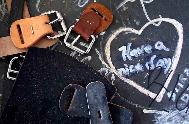 Handwritten messages on a tabletop mix with buckles and leather straps inside Brodhead Collar Shop, where the Amish make horse collars by hand near  Drakesville in southeast Iowa's Davis County.   It is among only a handful of rural Iowa counties in the 2010 Census to gain population (2.4 percent).  Much of that population growth is due to a steadily growing Amish population.  (Christopher Gannon/The Des Moines Register)
