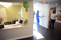 Patient Robert Consulmagno arrives for his appointment as Chris Visco (right) stands by the door at TerraVida Holistic Center, which is one of the first medical marijuana dispensary's in Pennsylvania to open Saturday, February 17, 2018 in Sellersville, Pennsylvania. (WILLIAM THOMAS CAIN / For The Inquirer)