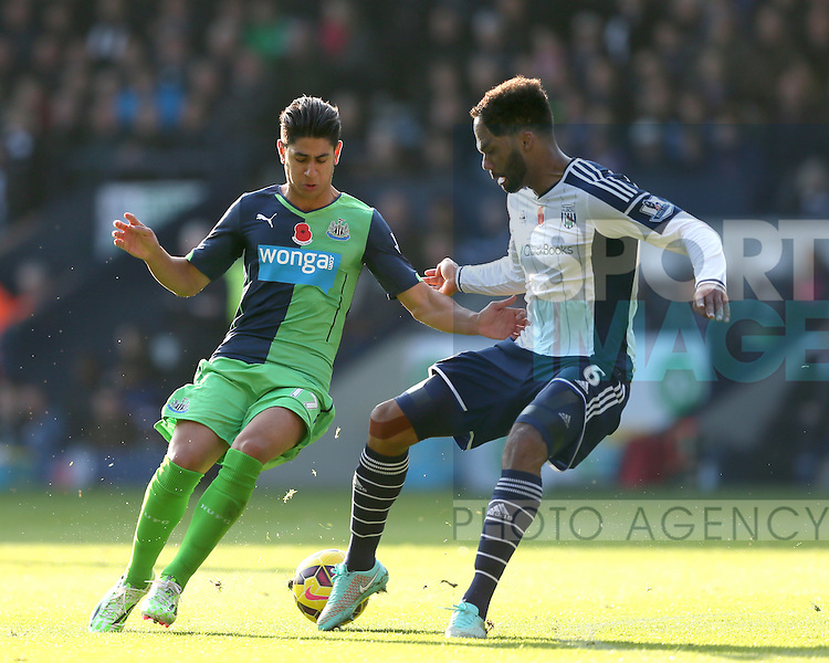 Ayoze Perez of Newcastle United tackled by Joleen Lescott of West Bromwich Albion - Barclays Premier League - WBA vs Newcastle Utd - Hawthorns Stadium - West Bromwich - England - 9th November 2014  - Picture Simon Bellis/Sportimage