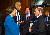 Democratic United States Senators Amy Klobuchar (Democrat of Minnesota), Cory Booker (Democrat of New Jersey), Richard Blumenthal (Democrat of Connecticut) and Chris Coons (Democrat of Delaware) discuss the first day of testimony of Judge Brett Kavanaugh before the US Senate Judiciary Committee on his nomination as Associate Justice of the US Supreme Court to replace the retiring Justice Anthony Kennedy on Capitol Hill in Washington, DC on Tuesday, September 4, 2018.<br /> Credit: Ron Sachs / CNP<br /> (RESTRICTION: NO New York or New Jersey Newspapers or newspapers within a 75 mile radius of New York City)