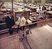 Precision drawings of each body part of a new Ford automobile are scanned by the coordinatograph (foreground). Ford Motor Company, Dearborn Michigan, 1966. Photo by John G. Zimmerman.
