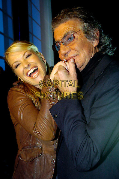 ANASTACIA & ROBERTO CAVALLI.Milan Fashion Week Women's Collection autumn/winter 2006/07 Emporio Armani .February 22nd, 2006.Photo: Omega/Garofalo/Capital Pictures.Ref: OME.half length brown leather jacket black glasses holding hands.www.capitalpictures.com.sales@capitalpictures.com.© Capital Pictures.